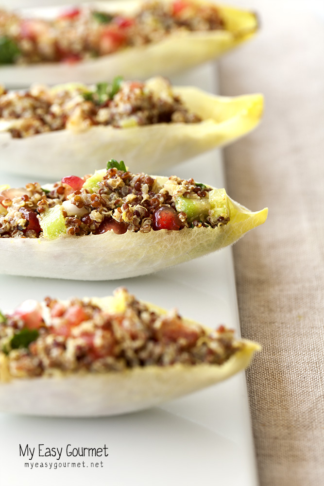 quinoa salad in endive leaves